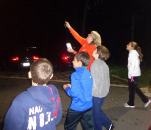 Naturalist Tammy leads a bat walk. Three naturalists, armed with three bat detectors, let the crowd eavesdrop on bats