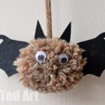 A photo of a pom pom bat craft from Red Ted Art
