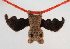 A photograph of a little crocheted bat decoration.