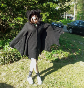 A photograph of blogger Rachael wearing a really cure bat jacket